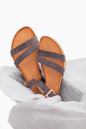 stylish, comfortable, grey women sandals on a white background 写真素材
