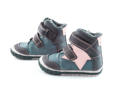 stylish, comfortable winter childrens shoes on a white background