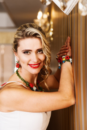Portrait of attractive blonde woman in jewelery Stock Photo