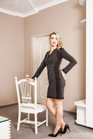 Portrait of attractive blonde woman in black dress Stock Photo