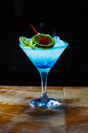 preparation of a beautiful blue cocktail. close-up 스톡 콘텐츠
