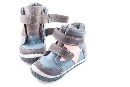 stylish, comfortable winter childrens shoes on a white background Foto de archivo