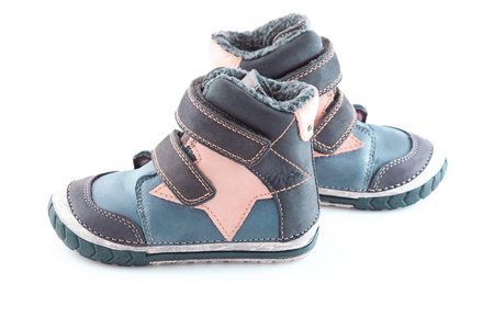 stylish, comfortable winter childrens shoes on a white background Stock fotó