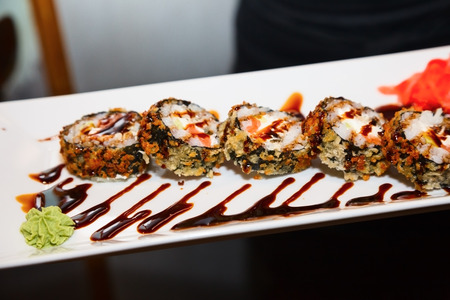 five sushi rolls on white plate. food