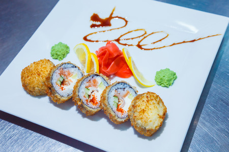 sushi rolls on white plate. food Imagens
