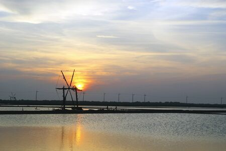 pan tropical: Beautiful landscape of a summer with a salt farm and wind wheel in Bang Lamung, Thailand