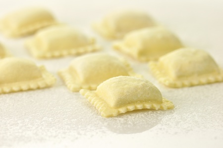 Uncooked ravioli pasta  ready for cooking  photo