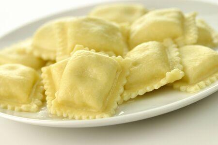 ravioli on a white plate, close up photo