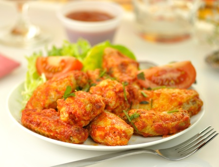 spicy: hot chicken wings with salad