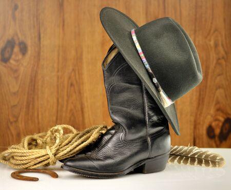 black cowboy hat and boots  版權商用圖片