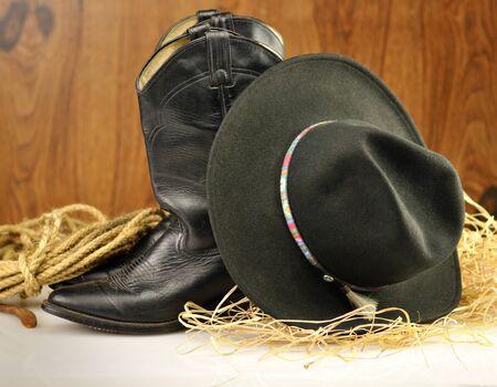 black cowboy hat and boots  Reklamní fotografie