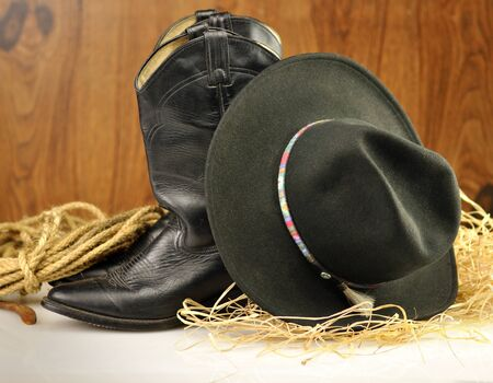 brown leather hat: black cowboy hat and boots  Stock Photo