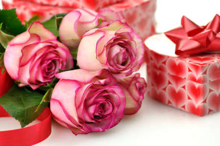 pink roses and gift for St.Valentines Day  photo