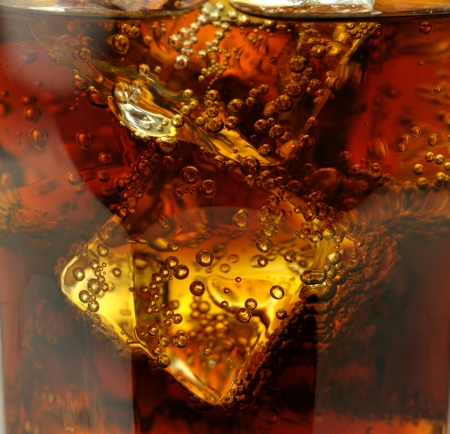 fizzy: cola with ice cubes close up