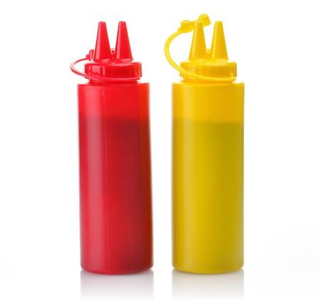 squirting ketchup: Bottles of Ketchup and Mustard.  Stock Photo