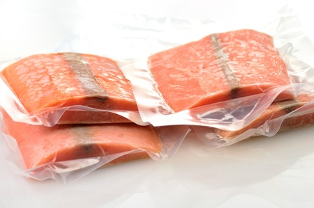 frozen fish: frozen salmon fillets in a vacuum package  Stock Photo