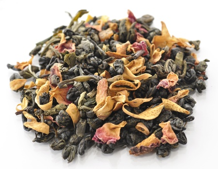 heap: green loose tea with fruits and flowers