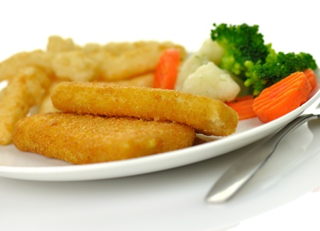 fish fillets with fried potato and vegetables photo