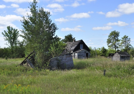 Old wooden home abandoned in the grassland photo