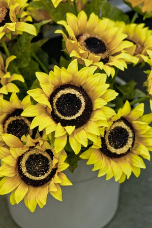 fake sunflowers in a pot, close up photo