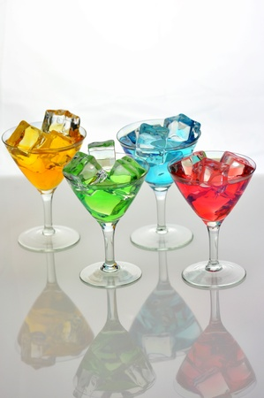 arrangement of colorful cocktails with ice cubes Stock Photo - 8982236