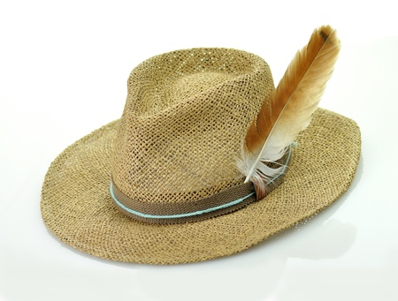 a straw hat with feather