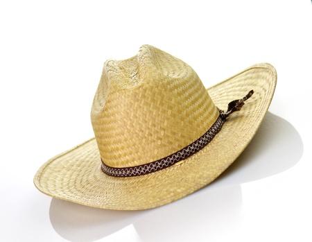 a vintage straw hat on white background photo