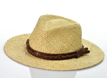 a vintage straw hat on white background photo