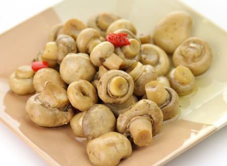 pickled mushrooms with red pepper on a plate Banco de Imagens