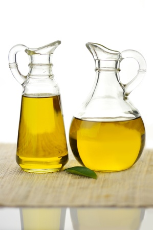 two bottles of olive oil on white background photo