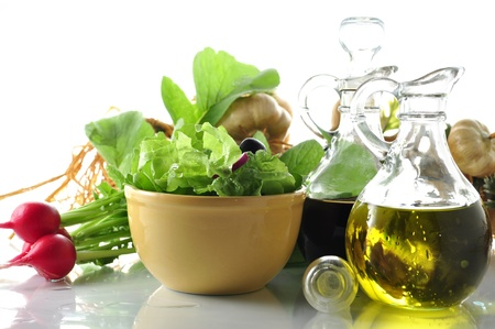 dressing table: fresh salad with vinegar and olive oil