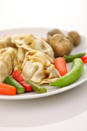 potstickers: Chinese pork dumplings filled with pork and vegetables