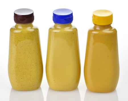 plastic  bottles of honey ,dijon and spicy brown mustard photo