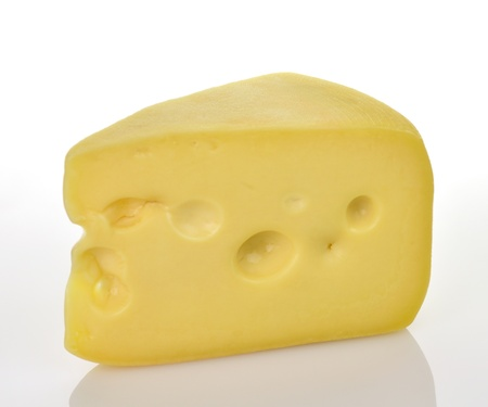 a piece of Swiss Cheese on a white background