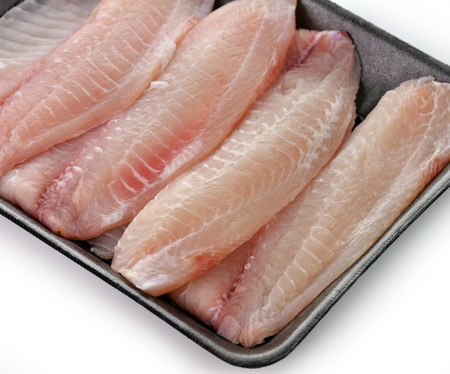 tilapia fillets in a package , close up shot photo