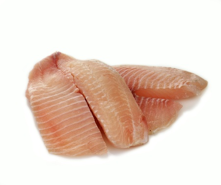 raw tilapia fillets on a white background Stock Photo