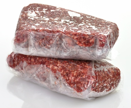 frozen ground meat in plastic package, close up photo