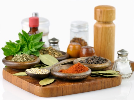 spices arrangement on a wooden board , close up Imagens