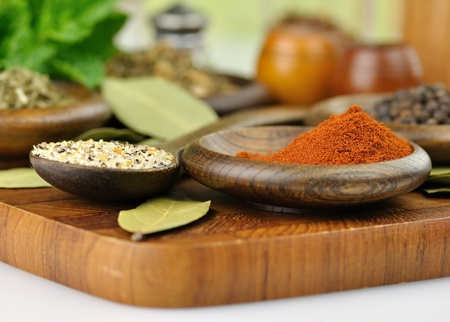 arrangement of spices on a wooden board , close up shot photo