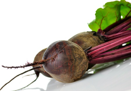 rote: fresh beet roots with leaves on white background