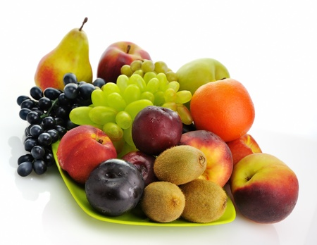 assortment of fresh fruits on a green dish Stock Photo