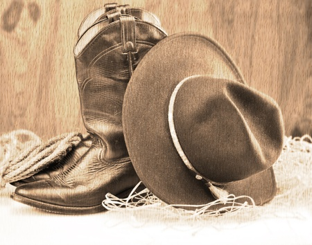 old style picture of cowboy boots and hat photo