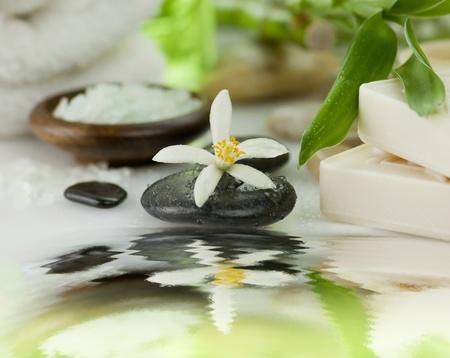 spa items - sea salt ,massage stones and soap  photo