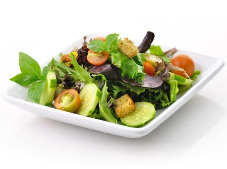 spinach salad: a fresh vegetable salad in a white dish Stock Photo