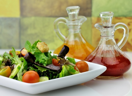 fresh vegetable salad with salad dressings photo
