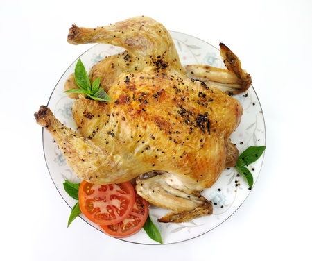Roasted chicken with spices ,  tomatoes and basil leaves photo