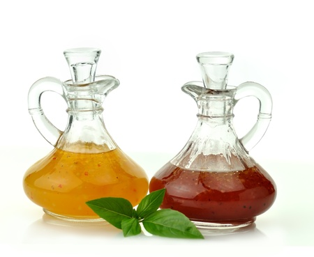 food dressing: italian and raspberry vinaigrette salad dressings in glass bottles