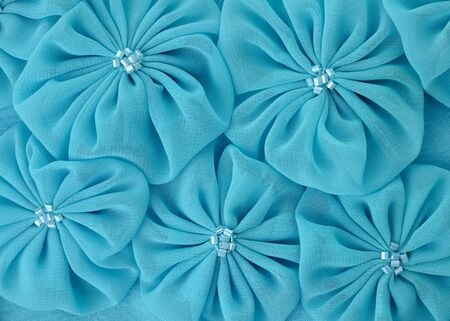 blue background: Blue fabric flowers , close up for background Stock Photo