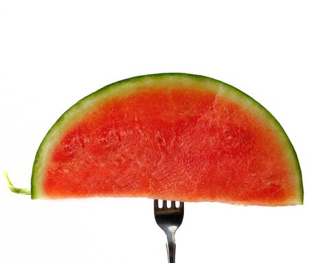 fresh juicy watermelon on a fork Stock Photo