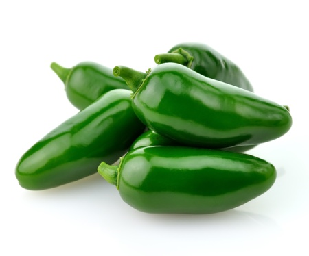 green background: hot green pepper  on white background, close up
